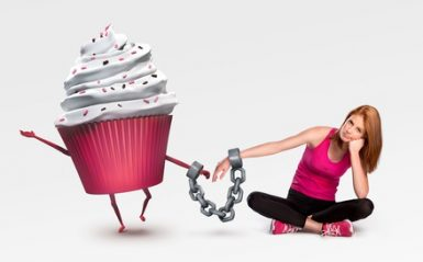 Woman handcuffed to a cupcake